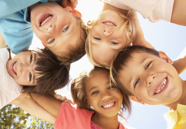 several kids smiling in a group