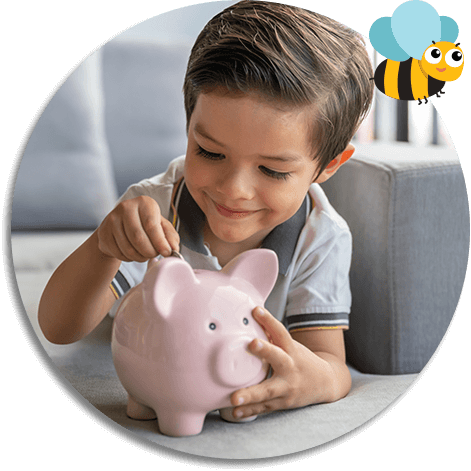 young boy filling piggy bank