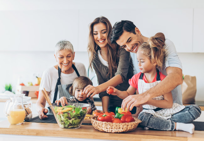 family cooking healthy food to eat that are good for teeth